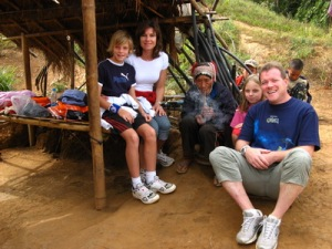A Swiss family meets an Ahka woman in northern Thailand